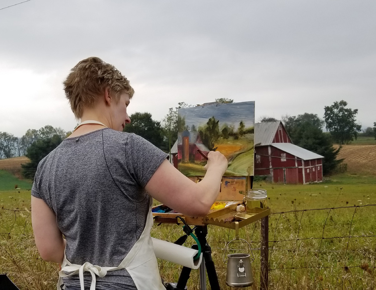sarah Pollock painting in field.